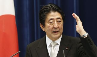 Japanese Prime Minister Shinzo Abe speaks during a press conference at the prime minister's official residence  in Tokyo, Wednesday, Oct. 7, 2015. (AP Photo/Koji Sasahara)
