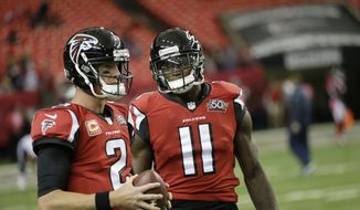 Atlanta Falcons quarterback Matt Ryan (2) speaks with Atlanta Falcons wide receiver Julio Jones (11) before the first half of an NFL football game between the Atlanta Falcons and the Houston Texans, Sunday, Oct. 4, 2015, in Atlanta. (AP Photo/David Goldman)