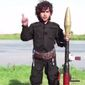 A child jihadi armed with a rocket-propelled grenade has threatened to execute President Obama in a chilling new video released by the Islamic State terrorist group. (Screen grab of Islamic State video via The Daily Mail)