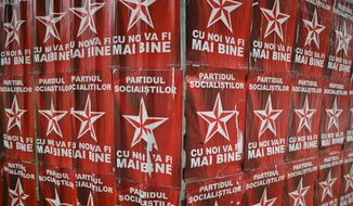This May 28, 2015 photo shows a wall of electoral banners for the Socialist Party in Chisinau, Moldova. Multiple Moldovan police and judicial authorities say a breakdown in cooperation between Russia and the West means that it is much harder to know whether smugglers are finding ways to move parts of Russia's vast store of radioactive materials. (AP Photo/Vadim Ghirda)