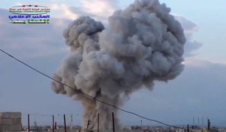 This image taken from video provided by the Syrian activist-based media group Syrian Revolutionary Command Council in Hama, which has-been verified and is consistent with other AP reporting, shows smoke rising after a Russian airstrike hit buildings in the town of Latamna in the area of Hama in Eastern Syria, Wednesday, Oct. 7, 2015. (Syrian Revolutionary Command Council in Hama via AP Video) MANDATORY CREDIT