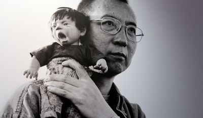 "RETRANSMISSION TO ADD COLUMBIA UNIVERSITY - This Tuesday, Feb. 7 2012 photo shows 2010 Nobel Peace Prize winner Liu Xiaobo holding a doll in a detail of a photograph by his wife, Chinese artist Liu Xia on display at during a preview of ""The Silent Strength of Liu Xia"" exhibit at The Italian Academy in Columbia University in New York. The photos were spirited out of China just before Liu was placed under house arrest after her husband, imprisoned in 2009 for urging democratic reform, won the Nobel. Her works are censored in her native country. The exhibition opens Thursday, Feb. 9, 2012. (AP Photo/Mary Altaffer) **FILE**"