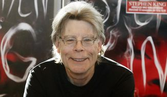 "In this Nov. 13, 2013, file photo, author Stephen King poses for the cameras, during a promotional tour for his novel, ""Doctor Sleep"" in Paris. (AP Photo/Francois Mori, File)"