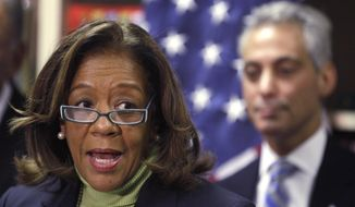 Chicago Public Schools CEO Barbara Byrd-Bennett speaks at a news conference, as Mayor Rahm Emanuel, background, listens in Chicago, in this Oct. 12, 2012, file photo. (AP Photo/M. Spencer Green, File)