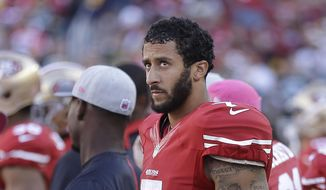 San Francisco 49ers quarterback Colin Kaepernick (7) stands on the sideline during the second half of an NFL football game against the Green Bay Packers in Santa Clara, Calif., Sunday, Oct. 4, 2015. The Packers won 17-3. (AP Photo/Ben Margot) **FILE**