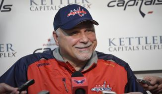 Washington Capitals head coach Barry Trotz talks to reporters during Media Day at NHL hockey training camp, Friday, Sept. 18, 2015, in Arlington, Va. (AP Photo/Nick Wass)