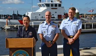 T. Bella Dinh-Zarr, vice chairman for the National Transportation Safety Board, answers questions about the search and investigation as Capt. Mark Fedor, chief of response, U. S. Coast Guard 7th District and Capt. Jason Neubauer, chief for Office of Investigations and Casualty Analysis, U. S. Coast Guard held a news conference aboard Coast Guard Sector Jacksonville in regards to the then-missing Jacksonville-based cargo ship El Faro on Wednesday Oct. 7, 2015. (Bob Mack/The Florida Times-Union via AP) ** FILE **