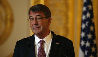 U.S. Secretary of Defense Ashton Carter speaks during a press conference held with Britain's Secretary of State for Defence Michael Fallon, at Lancaster house in London, Friday, Oct. 9, 2015. (AP Photo/Alastair Grant)