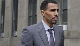 """The Atlanta Hawks' Thabo Sefolosha arrives to criminal court after a lunch break in New York, Thursday, Oct. 8, 2015. An NBA head coach has testified that the character of Sefolosha, a professional basketball player and Swiss national on trial after a confrontation with New York City police, is """"of the highest order."""" The case stems from a struggle outside the 1Oak nightclub in Chelsea after Indiana Pacers forward Chris Copeland and two women were stabbed. (AP Photo/Seth Wenig)"""