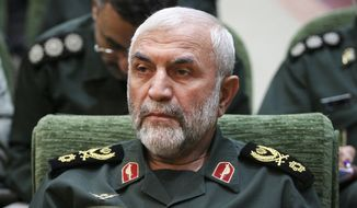 In this Dec. 9, 2009, photo, released by Iranian Tasnim News Agency, Iranian Revolutionary Guard Gen. Hossein Hamedani sits in a meeting in Tehran, Iran. Hamedani, a senior commander in Iran's powerful Revolutionary Guard, was killed by Islamic State extremists on the outskirts of the northern Syrian city of Aleppo, Iranian state media reported on Friday. (AP Photo/Tasnim News Agency, Hamed Malekpour)