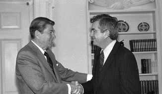 In this Feb. 27, 1985 file photo, then-President Ronald Reagan bids farewell to Jerry Parr, the Secret Service agent that he credited with saving his life during an assassination attempt on March 30, 1981. Parr retired after 22 years with the elite unit of bodyguards. Parr of Washington, D.C., died Friday at the age of 85. (AP Photo/Barry Thumma)