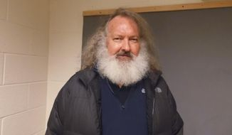 In a photo provided by the Vermont State Police, actor Randy Quaid stands in the Vermont State Police barracks in St. Albans, Vt., Friday, Oct. 9, 2015. (Vermont State Police via AP)