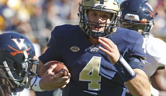 Pittsburgh quarterback Nathan Peterman (4) scrambles for a first down past Virginia cornerback Maurice Canady, left, in the fourth quarter of an NCAA college football game, Saturday, Oct. 10, 2015 in Pittsburgh. Pittsburgh won 26-19. (AP Photo/Keith Srakocic)