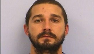 This booking mug provided by the Austin Police Department shows Shia LaBeouf. LaBeouf has been arrested and charged with public intoxication after an incident in Austin, Texas. (Austin Police Department via AP)