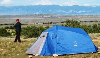 This undated photo shows camping out on the sagebrush plains below the Pryor Mountains in Big Horn County, Mont., offers a great view of the Beartooth Mountains to the west. The park is just one of many places people can visit in southeastern Montana, guided by a newly printed geotourism map. (Brett French/The Billings Gazette via AP) MANDATORY CREDIT