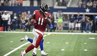 Atlanta Falcons wide receiver Julio Jones (11) grabs a pass during an NFL football game against the Dallas Cowboys Sunday, Sept. 27, 2015, in Arlington, Texas. (AP Photo/Michael Ainsworth)