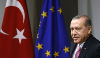 Critics say Turkish President Recep Tayyip Erdogan is orchestrating the government's deeply unpopular policies, such as stepping up military actions against Kurdish forces and cracking down on the media and opposition groups. (Associated Press)