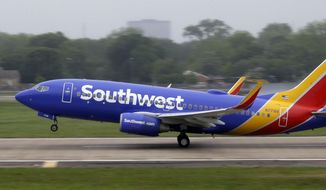 A Southwest airlines jet takes off from a runway at Love Field in Dallas, in this April 23, 2015, file photo. (AP Photo/LM Otero, File)