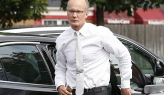 FILE-  In this Tuesday, Sept. 8, 2015 file photo dentist Walter Palmer, arrives back at his office following a lunch break in Bloomington, Minn.  A Zimbabwe Cabinet minister said Monday Oct. 12, 2015 that the country is no longer pressing for Palmer's extradition following the hunting and killing a well-known lion called Cecil. (AP Photo/Jim Mone-File)