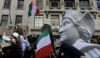 Participants in the Columbus Day Parade ride a float with a large bust of Christopher Columbus in New York, Monday, Oct. 12, 2015. Approximately 35,000 marchers participated in the annual celebration of Italian-American culture. (AP Photo/Seth Wenig)