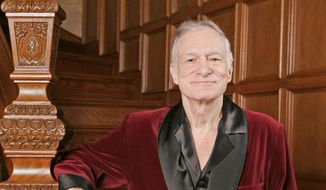 Playboy founder Hugh Hefner poses at the Playboy Mansion in the Holmby Hills area of Los Angeles in this April 7, 2006, file photo. (AP Photo/Kevork Djansezian, File)