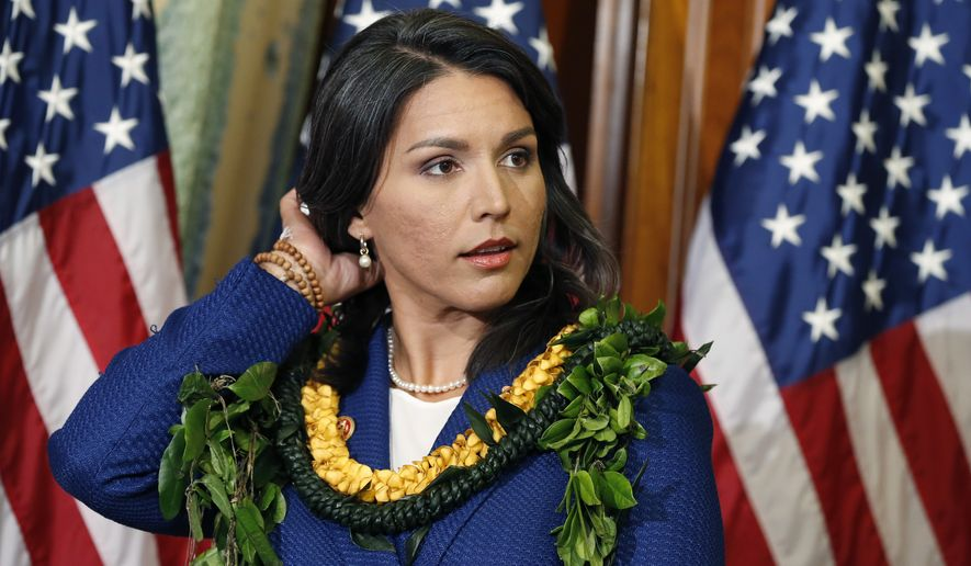 Rep. Tulsi Gabbard, Hawaii Democrat, claimed she was disinvited to Tuesday's debate in Las Vegas because she criticized the decision to strictly limit the number of Democratic presidential debates to six. (Associated Press)