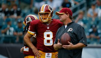Washington Redskins' Kirk Cousins, left, and head coach Jay Gruden talk before an NFL football game against the Philadelphia Eagles, Sunday, Sept. 21, 2014, in Philadelphia. (AP Photo/Matt Rourke)
