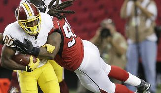 Washington Redskins wide receiver Jamison Crowder (80) runs as Atlanta Falcons defensive end Adrian Clayborn (99) makes the tackle during the first half of an NFL football game, Sunday, Oct. 11, 2015, in Atlanta. (AP Photo/Brynn Anderson)