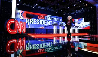 Michelle Poley walks on stage before a CNN Democratic presidential debate, Tuesday, Oct. 13, 2015, in Las Vegas. Democratic presidential candidates, Hillary Rodham Clinton, Jim Webb, Bernie Sanders, Lincoln Chafee, and Martin O'Malley will take the stage later today. (AP Photo/John Locher)