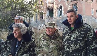 Rep. Duncan Hunter, California Republican, near the front lines on Tuesday with Ukrainian border officials.