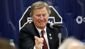 FILE - In this Dec. 26, 2014 file photo, South Carolina coach Steve Spurrier gestures during a news conference in Shreveport, La.  A person close to the situation says Spurrier told his team on Monday, Oct. 12, 2015, that he was retiring, effective immediately. The person spoke to The Associated Press on condition of anonymity because South Carolina has not publicly announced Spurrier's decision or who will be interim coach. (AP Photo/Rogelio V. Solis)
