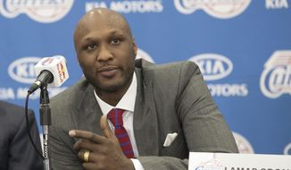 FILE - In this July 2, 2012 file photo, newly acquired Los Angeles Clippers forward Lamar Odom takes questions during an NBA basketball news conference in Los Angeles. Odom, the former NBA star and reality TV personality embraced by teammates and fans alike for his humble approach to fame, was hospitalized and his estranged wife Khloe Kardashian is by his side, after being found unresponsive in a Nevada brothel where he had been staying for days. (AP Photo/Damian Dovarganes, File)