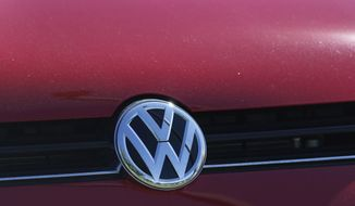 In this Sept. 24, 2015, file photo, the grille of a Volkswagen is decorated with the iconic company logo at the lot of a VW dealership in Boulder, Colo.  (AP Photo/Brennan Linsley, File)