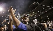 Chicago Cubs center fielder Dexter Fowler (24) claps hands and smoke cigar after the Cubs won 6-4 in Game 4 in baseball's National League Division Series against the St. Louis Cardinals, Tuesday, Oct. 13, 2015, in Chicago. (AP Photo/Nam Y. Huh)