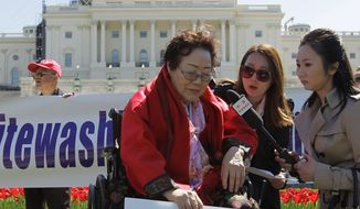 "Yong Soo Lee, of South Korea speaks to reporters on the West Lawn of Capitol Hill in Washington, Tuesday, April 28, 2015, Yong Soo Lee is one of dozens of surviving ""comfort women"" from Korea other Asian countries that were forced into sexual servitude by Japanese troops. (AP Photo/Luis M. Alvarez)"