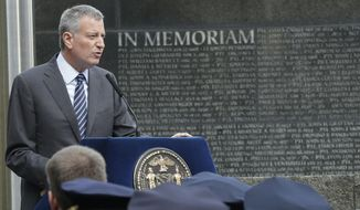 New York City Mayor Bill de Blasio speaks during a rededication ceremony at the Police Memorial Wall in Battery Park, Tuesday, Oct. 13, 2015, in New York. (Associated Press)