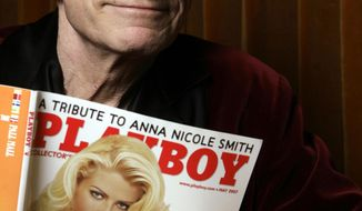 In this April 5, 2007 file photo, Playboy Enterprises founder Hugh Hefner poses with a copy of Playboy magazine featuring Anna Nicole Smith as Playmate of the Year, at the Playboy Mansion in Los Angeles. The magazine that helped usher in the sexual revolution in the 1950s and '60s by bringing nudity into America's living rooms announced this week that it will no longer run photos of completely naked women. Starting in March, 2016, Playboy's print edition will still feature women in provocative poses, but they will no longer be fully nude. (AP Photo/Damian Dovarganes, File)