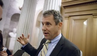 Sen. Sherrod Brown, D-Ohio, leaves the Senate chamber after a roll call vote at the Capitol in Washington, in this Nov. 12, 2014, file photo. (AP Photo/J. Scott Applewhite, File)