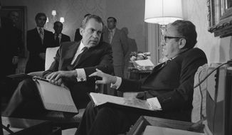 In this  Nov. 25, 1972, photo President Nixon confers with Henry A. Kissinger in New York after the presidential adviser returned from a week of secret negotiations in Paris with North Vietnam's Le Duc Tho. Documents released Tuesday, Dec. 2, 2008, from the Nixon years shed new light on just how much the Nixon White House struggled with growing public unrest over the protracted war in Vietnam. (AP Photo/File)