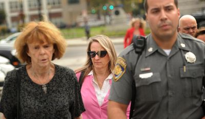 In this Tuesday, Oct. 13, 2015, photo, Jennifer Connell, center, is escorted to her car by marshals after her lawsuit against her Westport nephew was found in his favor in Superior Court in Bridgeport, Conn.  (Brian A. Pounds/Hearst Connecticut Media via AP)