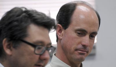 In this July 9, 2015, photo, Seth Jeffs, right, the brother of Warren Jeffs, the imprisoned leader of a polygamist sect, participates in a state water board meeting in Pierre, S.D. South Dakota regulators approved Wednesday, Oct. 14, 2015, the secretive polygamist group's request to draw water more quickly at its Black Hills compound even though the sect declined to provide many details about how many people live there. (AP Photo/James Nord, File)
