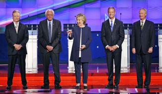 Democratic presidential candidates from left, former Virginia Sen. Jim Webb, Sen. Bernie Sanders of Vermont, former Secretary of State Hillary Rodham Clinton, former Maryland Gov. Martin O'Malley, and former Rhode Island Gov. Lincoln Chafee take the stage before the CNN Democratic presidential debate Tuesday, Oct. 13, 2015, in Las Vegas. (AP Photo/John Locher)