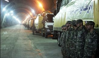 Soldiers stand in formation inside a tunnel of one of Iran's underground missile facilities (Image: Fars News Agency)
