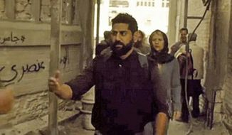 "Artists hired by Showtime's ""Homeland"" to draw graffiti on one of its sets in Berlin are taking credit for Arabic messages calling the show racist, which were captured onscreen during a recent episode unbeknownst to the show's creators. (Showtime via @annieslem)"