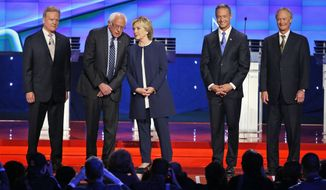 Democratic presidential candidates from left, former Virginia Sen. Jim Webb, Sen. Bernie Sanders, I-Vt., Hillary Rodham Clinton, former Maryland Gov. Martin O'Malley, and former Rhode Island Gov. Lincoln Chafee take the stage before the CNN Democratic presidential debate Tuesday, Oct. 13, 2015, in Las Vegas. (AP Photo/John Locher)