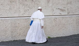 Pope Francis leaves after a morning session of the Synod of bishops, Friday, Oct. 16, 2015. (AP Photo/Alessandra Tarantino)