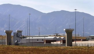 A guard tower looms over a federal prison complex which houses a Supermax facility outside Florence, in southern Colorado, Thursday, Oct. 15, 2015. The prison is among those being assessed by a team of Pentagon officials as potential sites to house Guantanamo detainees amid the Obama administration's stalled effort to close the controversial facility. (AP Photo/Brennan Linsley)