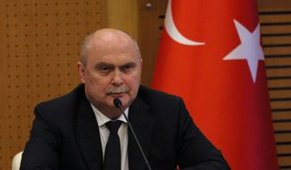 Turkish foreign minister Feridun Sinirlioglu attends a press conference in Ankara, Turkey, Friday, Oct. 16, 2015. Turkish jets on Friday shot down an unidentified drone that had violated Turkey's airspace at the border with Syria, the military said. (AP Photo/Burhan Ozbilici)