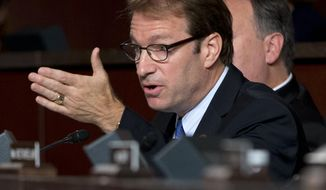 Rep. Peter Roskam, Illinois Republican, speaks on Capitol Hill in Washington on Sept. 17, 2014. (Associated Press) **FILE**