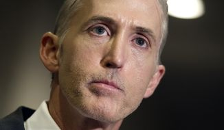 In this Sept. 15, 2015, file photo, House Benghazi Committee Chairman Trey Gowdy, R-S.C. speaks reporters on Capitol Hill  in Washington. Gowdy is a man under siege. The three-term Republican congressman from South Carolina chairs the embattled House committee investigating the deadly 2012 attacks in Benghazi, Libya. (AP Photo/Cliff Owen, File)